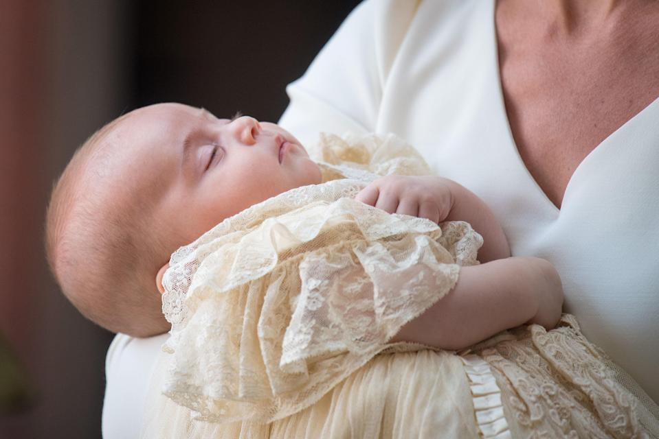 Prince Louis in his mother's arms at his St James' Palace christening [Photo: PA]