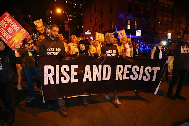 "<p>A group of people carry a ""Rise and Resist"" banner at the 44th annual Village Halloween Parade in New York City on Oct. 31, 2017. (Photo: Gordon Donovan/Yahoo News) </p>"