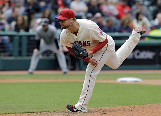 Cleveland Indians starting pitcher Corey Kluber follows through against the Chicago White Sox in the seventh inning of a baseball game on Sunday, May 4, 2014, in Cleveland. (AP Photo/Mark Duncan)