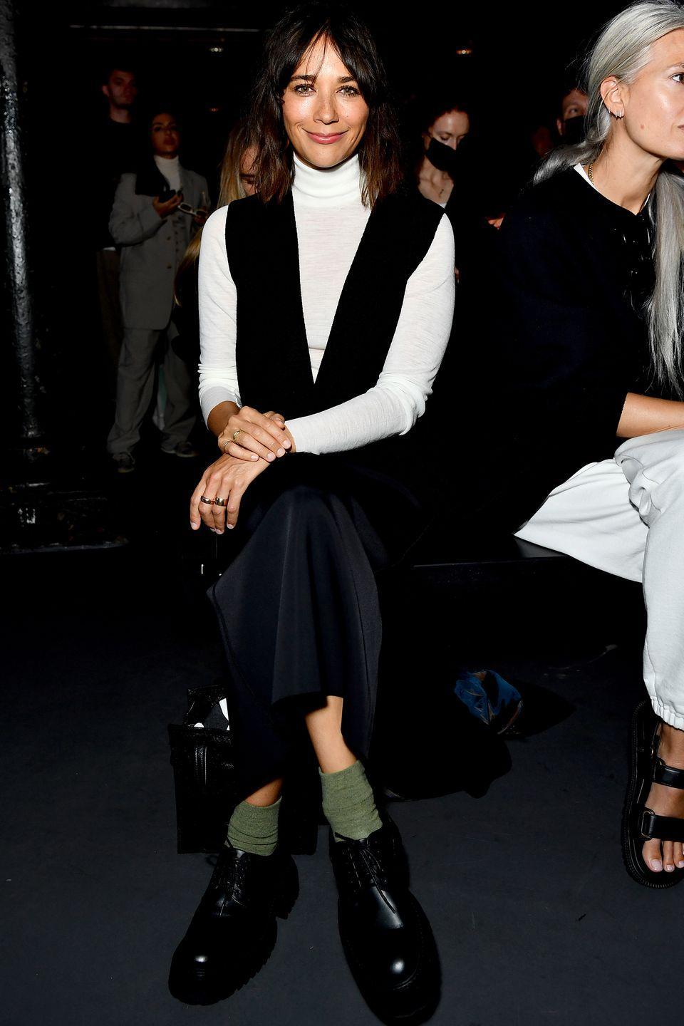 <p><strong>21 September</strong></p><p>Rashida Jones sat on the front row in a white turtleneck and a black slip dress.</p>