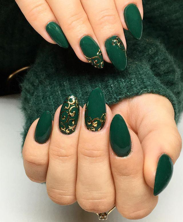 """<p>This lovely, forest green color is pretty as is, but some fun, gold decals take this manicure to the next level.</p><p><a class=""""link rapid-noclick-resp"""" href=""""https://www.amazon.com/Transfer-Metallic-Butterfly-Decorations-Separator/dp/B07FBD4CC2?tag=syn-yahoo-20&ascsubtag=%5Bartid%7C10055.g.26310821%5Bsrc%7Cyahoo-us"""" rel=""""nofollow noopener"""" target=""""_blank"""" data-ylk=""""slk:SHOP GOLD NAIL DECALS"""">SHOP GOLD NAIL DECALS </a></p><p><a href=""""https://www.instagram.com/p/B5YbV4vAlaF/&hidecaption=true"""" rel=""""nofollow noopener"""" target=""""_blank"""" data-ylk=""""slk:See the original post on Instagram"""" class=""""link rapid-noclick-resp"""">See the original post on Instagram</a></p>"""