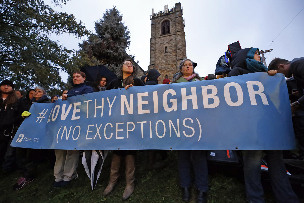 People hold a sign in the Squirrel Hill section of Pittsburgh on Oct. 27, 2018, after the mass shooting. (Photo: Gene J. Puskar/AP)