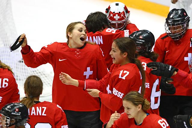SOCHI, RUSSIA - FEBRUARY 20: Katrin Nabholz #2 and Jessica Lutz #17 of Switzerland celebrate after defeating Sweden 4-3 during the Ice Hockey Women's Bronze Medal Game on day 13 of the Sochi 2014 Winter Olympics at Bolshoy Ice Dome on February 20, 2014 in Sochi, Russia. (Photo by Doug Pensinger/Getty Images)