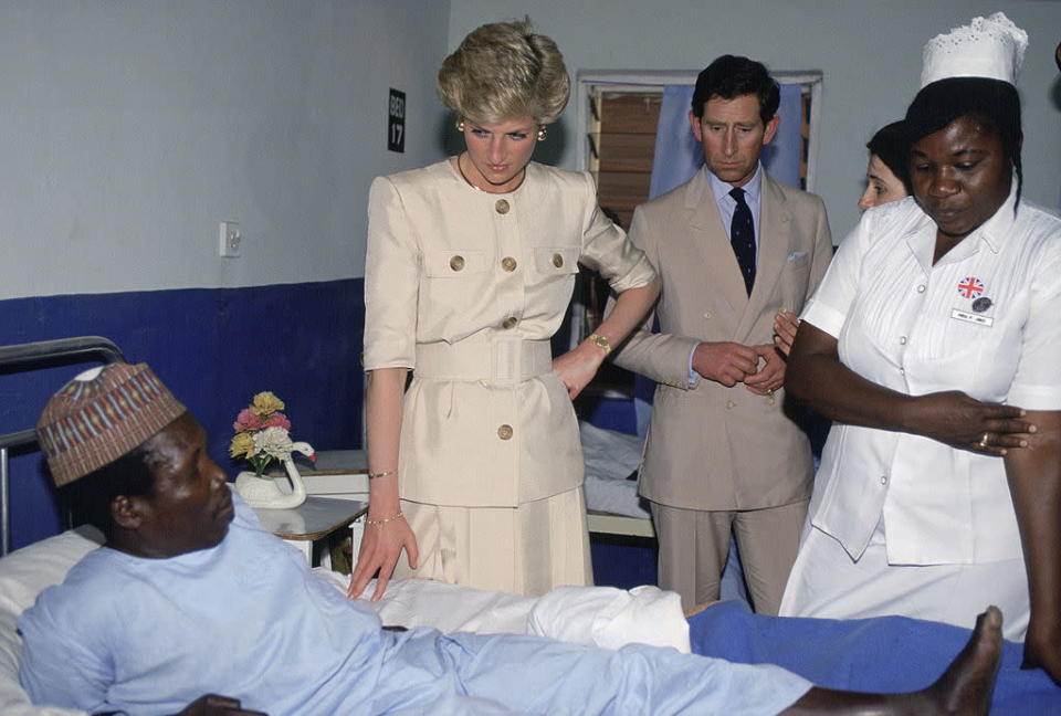 Diana and Charles visit a leprosy hospital In Borno Nigeria on March 17, 1990. <em>(Photo by Tim Graham/Getty Images)</em>