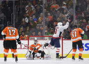 Washington Capitals' Alex Ovechkin, second from right, raises his stick after scoring a goal past Philadelphia Flyers' goalie Petr Mrazek (34) during the second period of an NHL hockey game, Sunday, March 18, 2018, in Philadelphia. (AP Photo/Derik Hamilton)