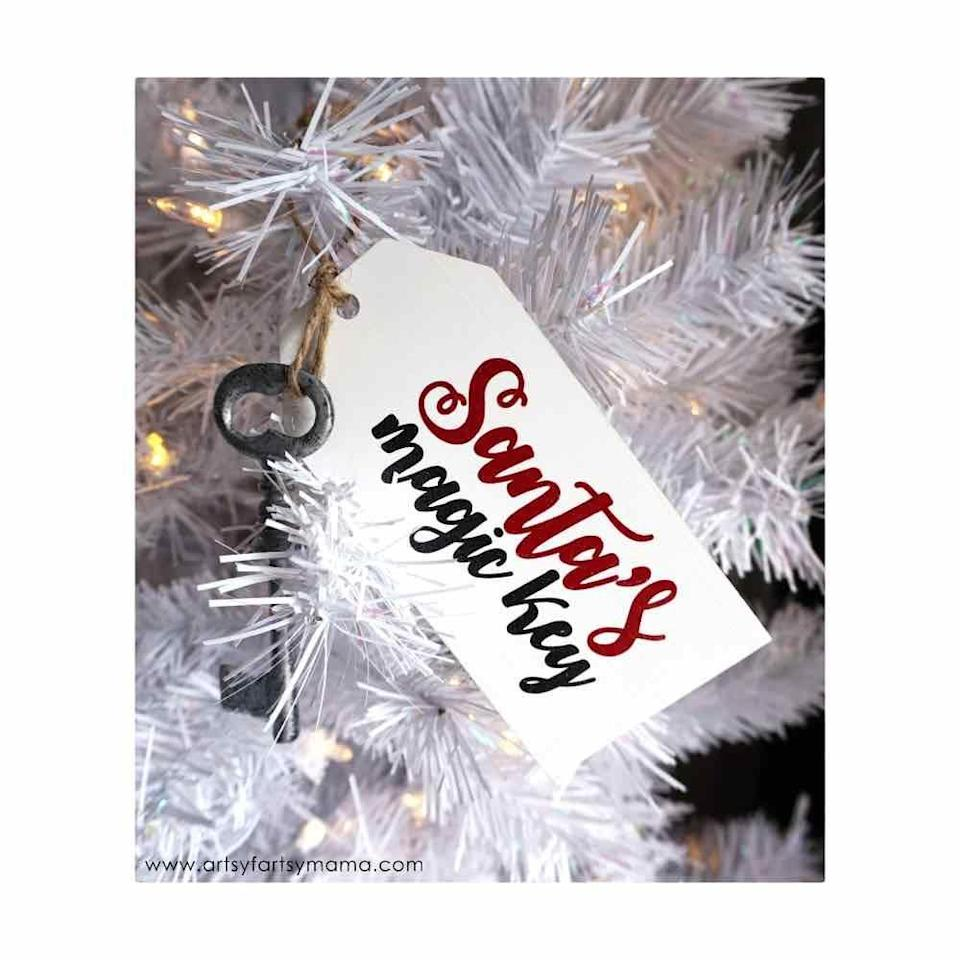 """<p>Paint a wooden gift tag, add some stenciled art, then add a vintage key, and—voila—you've got yourself the way into Santa's workshop. </p><p><em>Get the tutorial at <a href=""""https://www.artsyfartsymama.com/2016/12/santas-magic-key-ornament.html"""" rel=""""nofollow noopener"""" target=""""_blank"""" data-ylk=""""slk:Artsy Fartsy Mama"""" class=""""link rapid-noclick-resp"""">Artsy Fartsy Mama</a>.</em></p><p><a class=""""link rapid-noclick-resp"""" href=""""https://www.amazon.com/Wooden-Labels-Present-Bottles-Decoration/dp/B01180NO6M?tag=syn-yahoo-20&ascsubtag=%5Bartid%7C10072.g.34443405%5Bsrc%7Cyahoo-us"""" rel=""""nofollow noopener"""" target=""""_blank"""" data-ylk=""""slk:SHOP WOODEN GIFT TAG"""">SHOP WOODEN GIFT TAG</a></p>"""