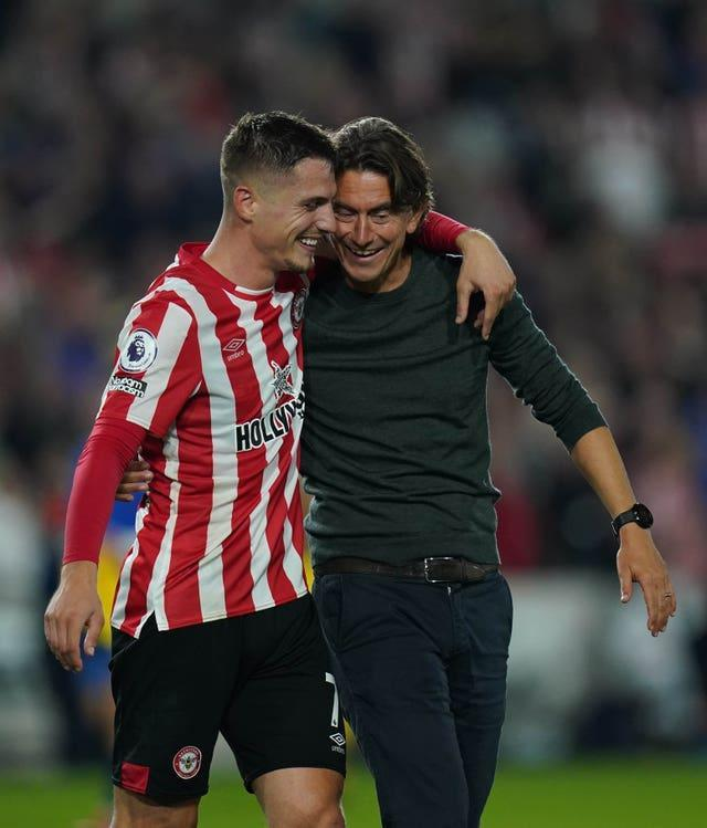 Brentford's Sergi Canos and manager Thomas Frank celebrate their 3-3 draw with Liverpool