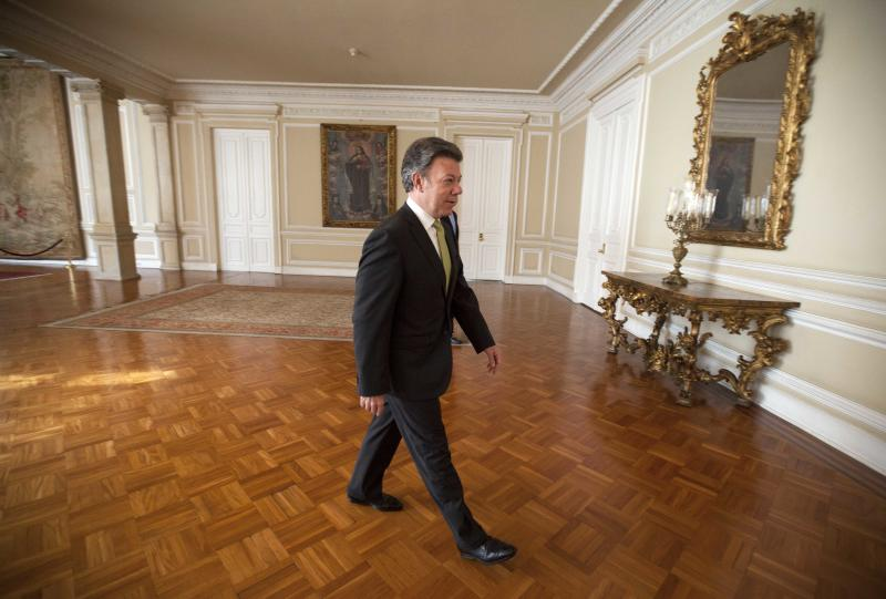 Colombia's President Juan Manuel Santos arrives for an interview at the presidential palace in Bogota, Colombia, Thursday, Aug. 8, 2013. Santos will host U.S. Secretary of State John Kerry during a one-day visit that begins Sunday night. (AP Photo/Fernando Vergara)