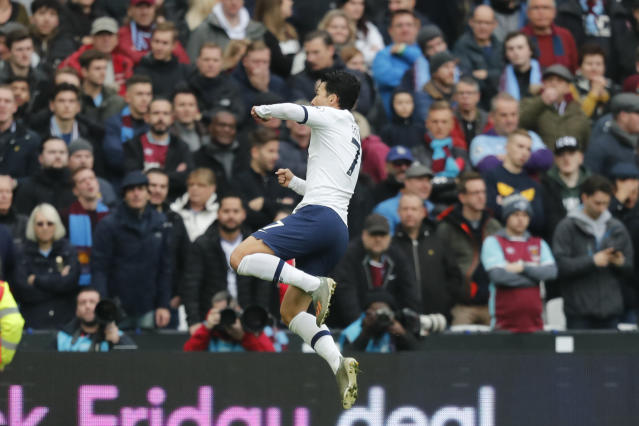 Tottenham's Son Heung-min celebrates after he scored his side's first goal during the English Premier League soccer match between West Ham and Tottenham, at London stadium, in London, Saturday, Nov. 23, 2019.(AP Photo/Frank Augstein)