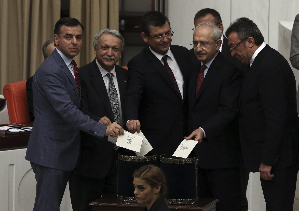 Lawmakers of the main opposition Republican People's Party and their leader Kemal Kilicdaroglu, second right, cast their votes as Turkey's parliament debate proposed amendments to the country's constitution that would hand President Recep Tayyip Erdogan's largely ceremonial presidency sweeping executive powers, in Ankara, Turkey, Wednesday, Jan. 18, 2017. Legislators on Wednesday resume their deliberations on the proposed amendments which last week resulted in brawls between ruling and opposition party lawmakers. (AP Photo/Burhan Ozbilici)