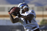 Las Vegas Raiders wide receiver Henry Ruggs III makes a catch during an NFL football practice Saturday, July 31, 2021, in Henderson, Nev. (AP Photo/David Becker)