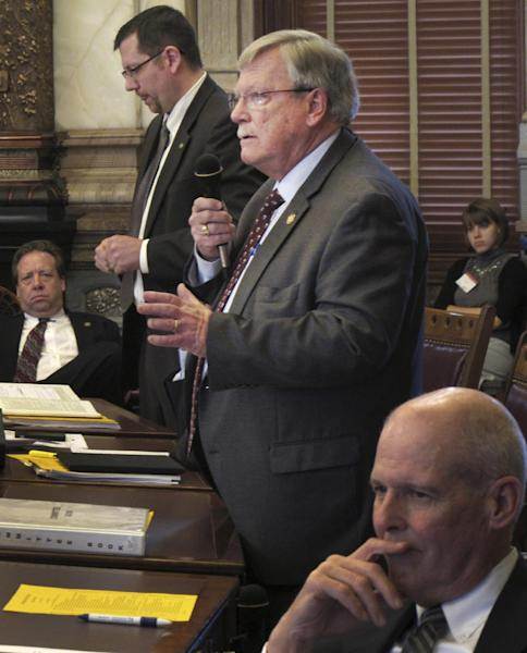 In this Thursday, Feb. 23, 2012 file photograph, Kansas Senate Judiciary Committee Chairman Tim Owens, standing to the right, an Overland Park Republican, debates Sen. Terry Bruce, standing to the left, a Hutchinson Republican, at the Statehouse in Topeka, Kan. Frustrated by their inability to achieve some policy goals, conservatives in Republican states are turning against moderate members of their own party, trying to drive them out of state legislatures to clear the way for reshaping government across a wide swath of mid-America controlled by the GOP. Moderate GOP incumbent Sen. Tim Owens, one of the targets. (AP Photo/John Hanna)