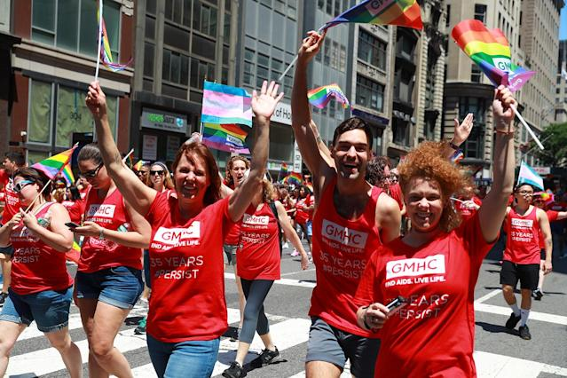 <p>People wave rainbow flags during the N.Y.C. Pride Parade in New York on June 25, 2017. (Photo: Gordon Donovan/Yahoo News) </p>
