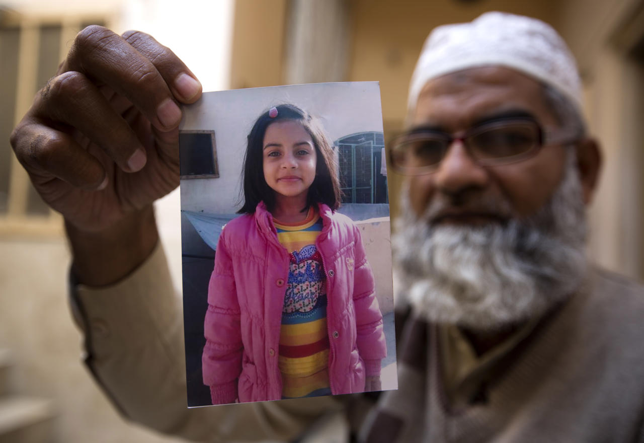 <p> In this Thursday, Jan. 18, 2018 photo, Mohammed Amin shows a picture of his seven year-old daughter, Zainab Ansari in Kasur, Pakistan. The brutal rape of Zainab, whose body was left in a garbage dump earlier this month, has roiled Conservative Pakistan and revealed a sexual predator who has raped and killed at least 11 girls in Zainab's hometown of Kasur. He is still at large. (AP Photo/B.K. Bangash) </p>