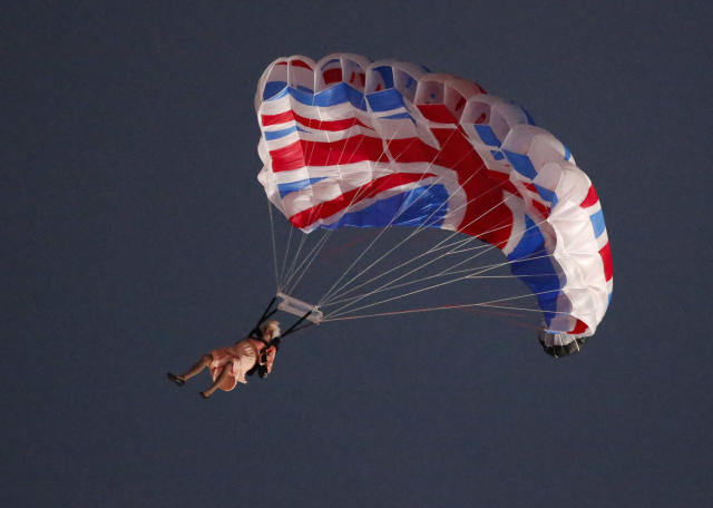 A performer playing the role of Britain's Queen Elizabeth parachutes from a helicopter during the opening ceremony of the London 2012 Olympic Games at the Olympic Stadium July 27, 2012. REUTERS/Fabrizio Bensch (BRITAIN - Tags: OLYMPICS SPORT)