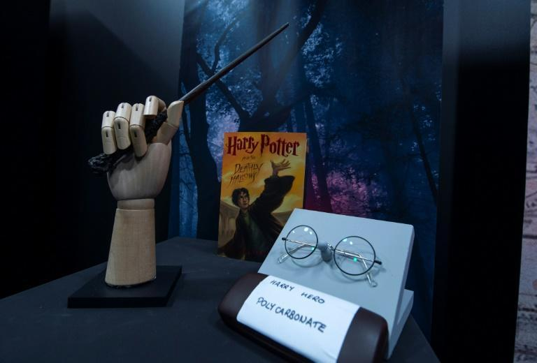 """A wand and eyeglasses used by Daniel Radcliffe in the final two """"Harry Potter"""" films was donated by studio Warner Bros to raise funds for charity"""