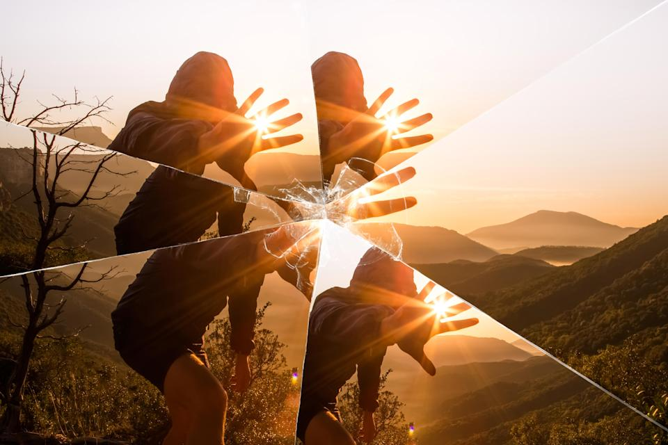 INJY-Mirror-Mystic picture of guy playing with sunlight during sunrise in the nature seen through a broken mirror.