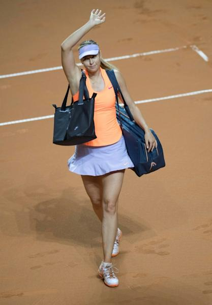 Russia's Maria Sharapova leaves the court after losing against Kristina Mladenovic in the semi-finals of the WTA Porsche Tennis Grand Prix in Stuttgart, southwestern Germany, on April 29, 2017