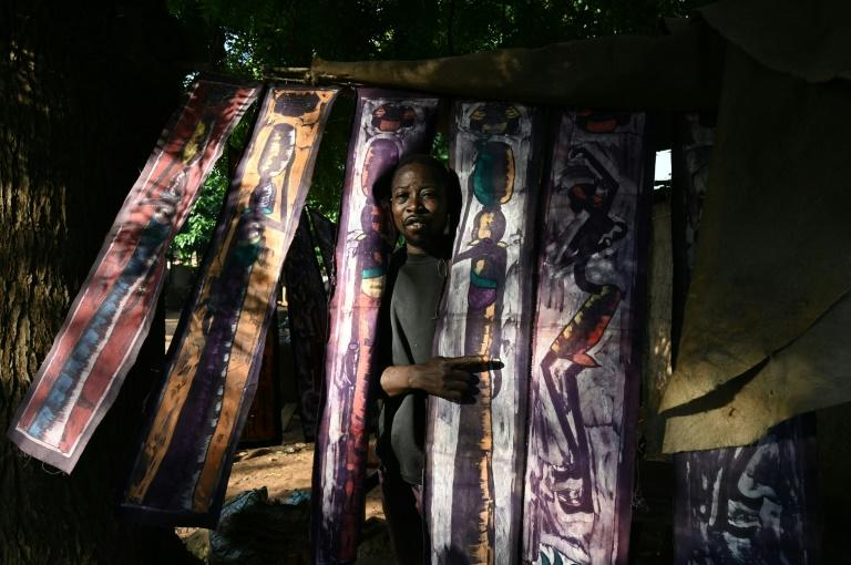 Sales of crafts like these batik print textiles have fallen as tourist numbers shrink (AFP Photo/ISSOUF SANOGO)