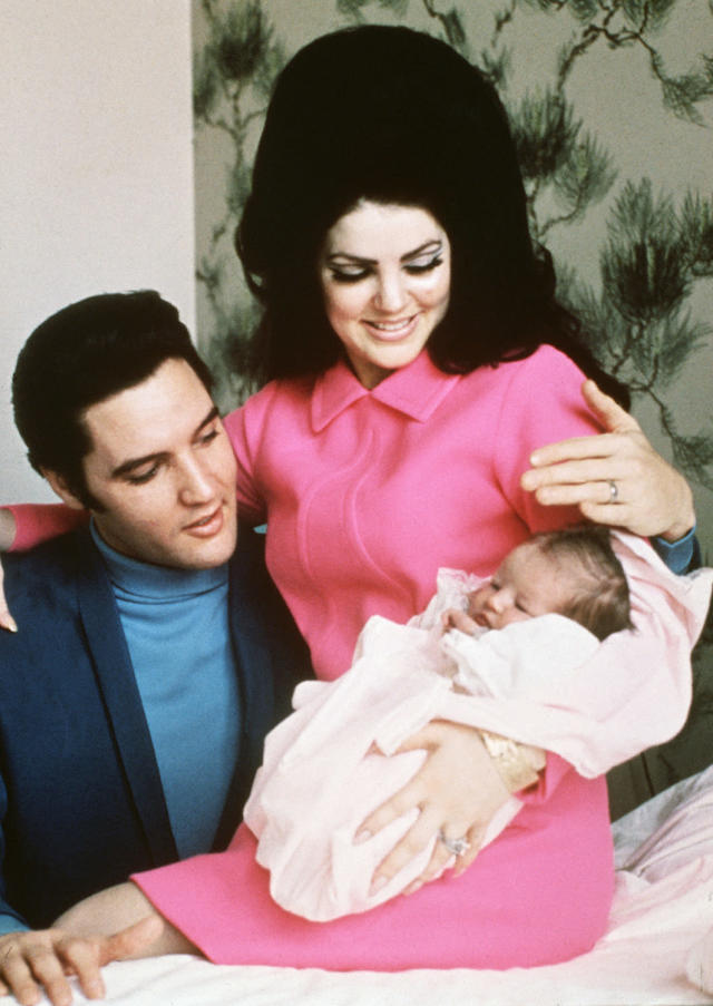 <p>Lisa Marie Presley was born on Feb. 1, 1968 — nine months after her parents married — and made her public debut just four days later. Here are her parents, gazing at the apple of their eyes, at the Baptist Memorial Hospital in Memphis, Tenn., on Feb. 5. (Photo: Getty Images) </p>