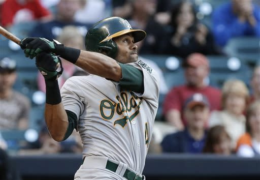 Oakland Athletics' Coco Crisp watches his solo home run against the Houston Astros in the fourth inning of a baseball game Saturday, April 6, 2013, in Houston. (AP Photo/Pat Sullivan)