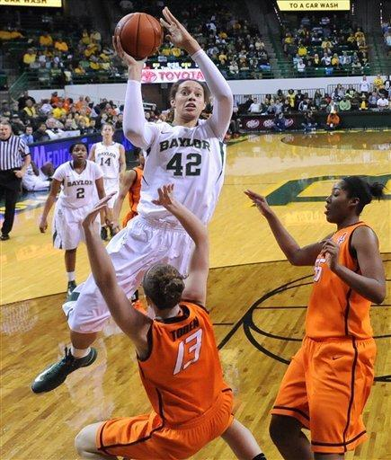 Baylor's Brittney Griner (42) shoots over Oklahoma State Morgan Toben (13) and LaShawn Jones, right, in the second half of a NCAA college basketball game on Sunday, Jan. 6, 2013, in Waco, Texas. Baylor won 83-49. (AP Photo/Waco Tribune Herald, Rod Aydelotte)