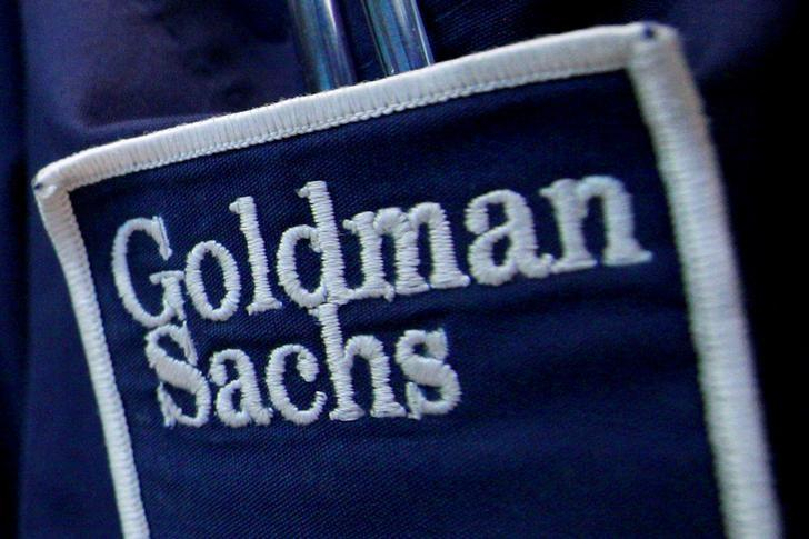 The logo of Dow Jones Industrial Average stock market index listed company Goldman Sachs (GS) is seen on the clothing of a trader working at the Goldman Sachs stall on the floor of the New York Stock Exchange