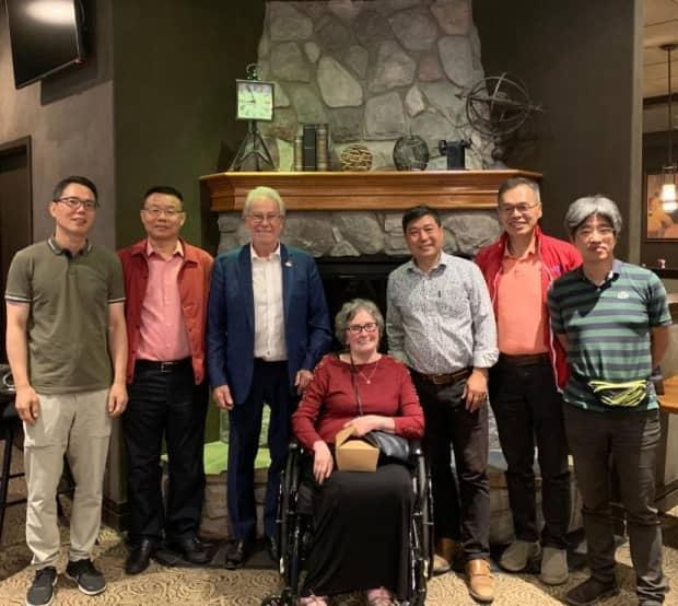 One of their first stops on the trip was Williams Lake, where they met with mayor Walt Cobb. The group also got to enjoy moose meat and wild mushrooms for dinner with a local family.  (Submitted by Eilieen Lao - image credit)