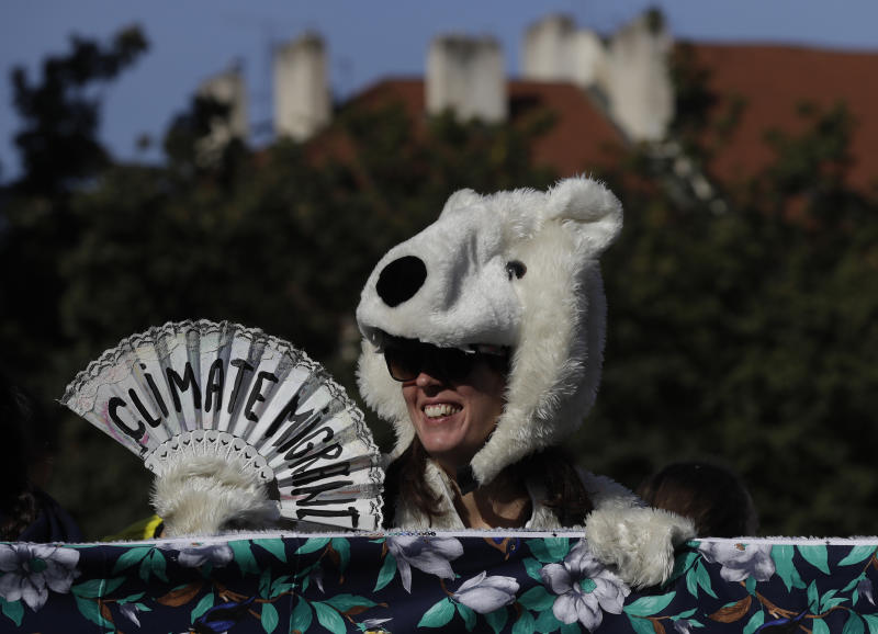 A girl wearing a polar bear costume joins a protest at the Old Town Square in Prague, Czech Republic, Friday, Sept. 20, 2019. Several hundreds of protestors gathered in response to a day of worldwide demonstrations calling for action to guard against climate change. (AP Photo/Petr David Josek)