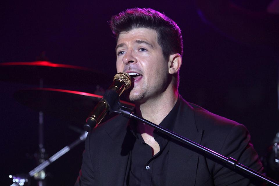 """FILE - In this Oct. 23, 2013 file photo, Robin Thicke performs at GQ's Gentlemen Give Back Concert at the Highline Ballroom, in New York. Lorde joins Macklemore & Ryan Lewis for """"The Grammy Nominations Concert Live!! _ Countdown to Music's Biggest Night,"""" to be held on Dec. 6, 2013, at the Nokia Theatre L.A. Live. T.I. and members of Earth, Wind & Fire will perform with Thicke for """"Blurred Lines,"""" the year's longest running No. 1 hit. (Photo by Greg Allen/Invision/AP)"""