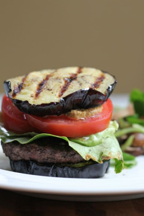 Grilled eggplant buns and grass-fed beef make these burgers something you can really get excited over.