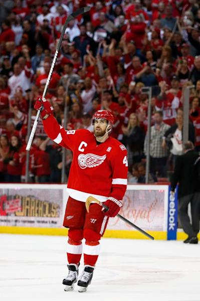 Henrik Zetterberg of the Detroit Red Wings salutes the fans after their 4-1 win over the New Jersey Devils, at the final NHL game to be played at Joe Louis Arena in Detroit, Michigan, on April 9, 2017