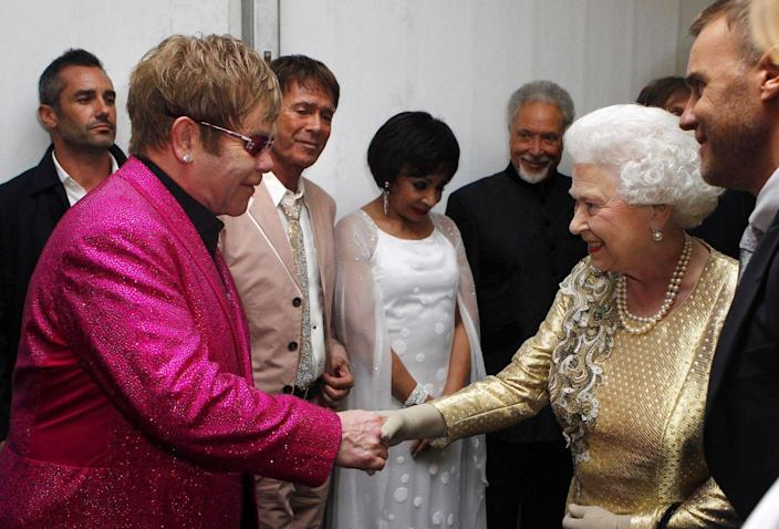 <p>What'd you expect? Elton John to wear something understated? The legendary singer went with a colorful blazer and sunglasses, of course.</p>