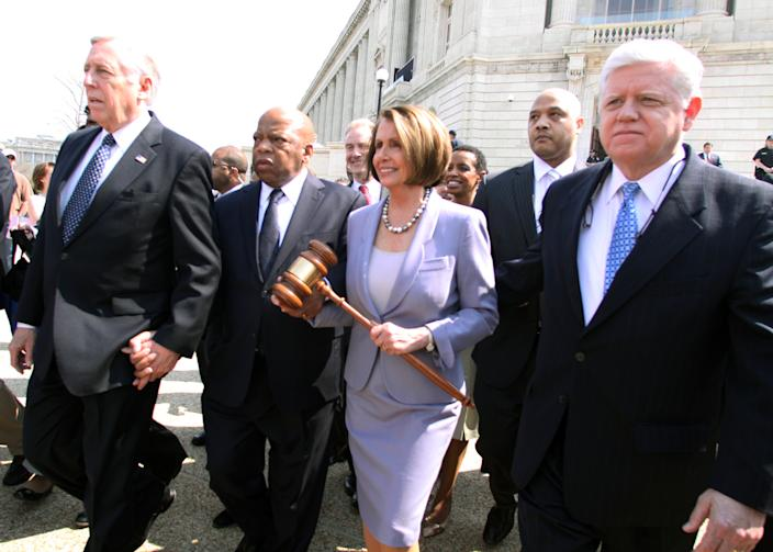 Speaker Nancy Pelosi, D-Calif., walks with, from left. Reps. Steny Hoyer, D-Md, John Lewis, D-Ga., Andre Carson, D-Ind., 2nd right, and John Larson, D-Conn., before Congress is set to vote on health care reform legislation on March 21, 2010 on Capitol Hill in Washington. (Photo: Lauren Victoria Burke/AP)
