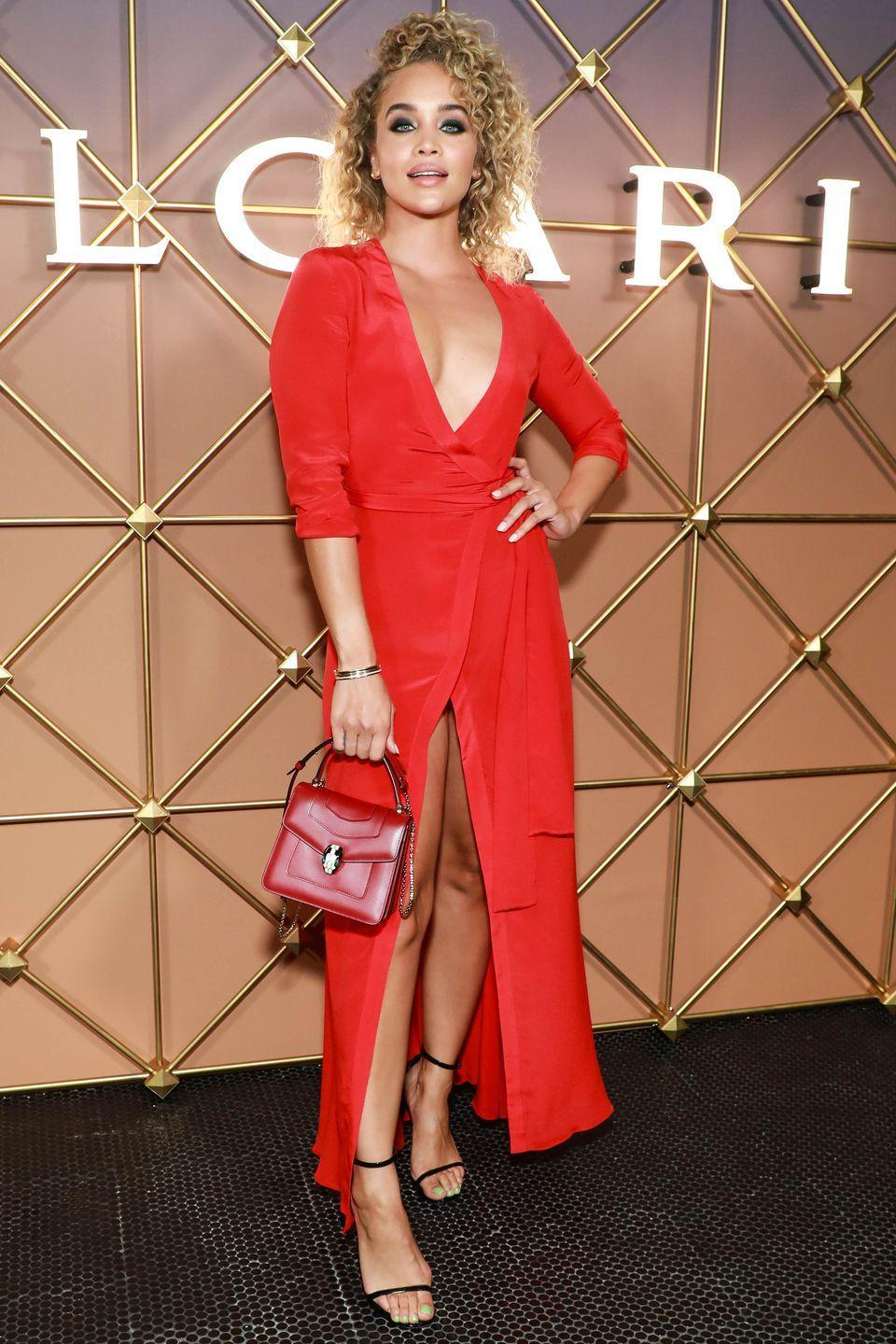 <p><strong>8 September </strong><br></p><p>Jasmine Sanders went bright in a red wrap dress and carried a Bulgari box bag. </p>