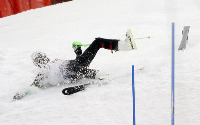 Mexico's Hubertus von Hohenlohe crashes during the first run of the men's slalom at the Sochi 2014 Winter Olympics, Saturday, Feb. 22, 2014, in Krasnaya Polyana, Russia. (AP Photo/Christophe Ena)