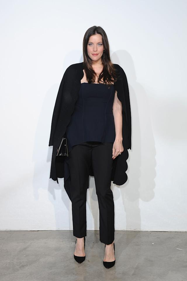 Liv Tyler mixing blue and black at theDior Cruise Collection 2014 show on May 18, 2013 in Monaco.