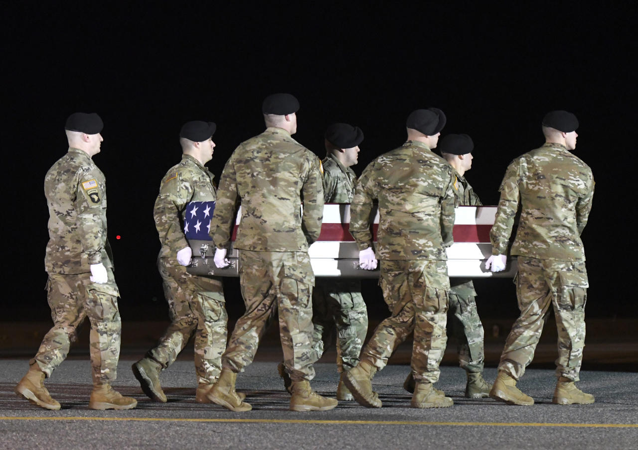An Army carry team moves a transfer case containing the remains of Spc. Branden Tyme Kimball, early Friday, Feb. 14, 2020, at Dover Air Force Base, Del. According to the Department of Defense, Kimball, 21, of Central Point, Ore., died at Bagram Airfield, Afghanistan, from a non-combat related incident. (AP Photo/Steve Ruark)