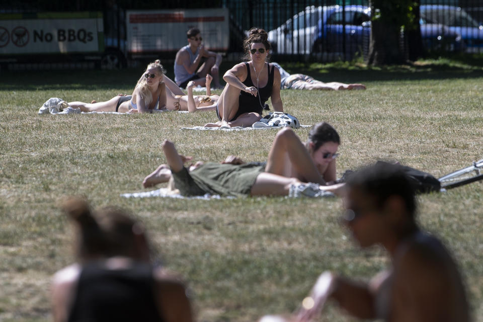 People enjoy the sun in London Fields park in East London as people flock to parks and beaches with lockdown measures eased.