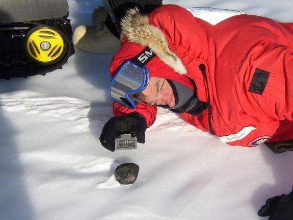 NASA astronaut Stan Love poses with a meteorite found in Antarctica during a 2004-2005 expedition by the Antarctic Search for Meteorites Program at Case Western Reserve University. He ventured back to Antarctica in December 2012 to seek out mor