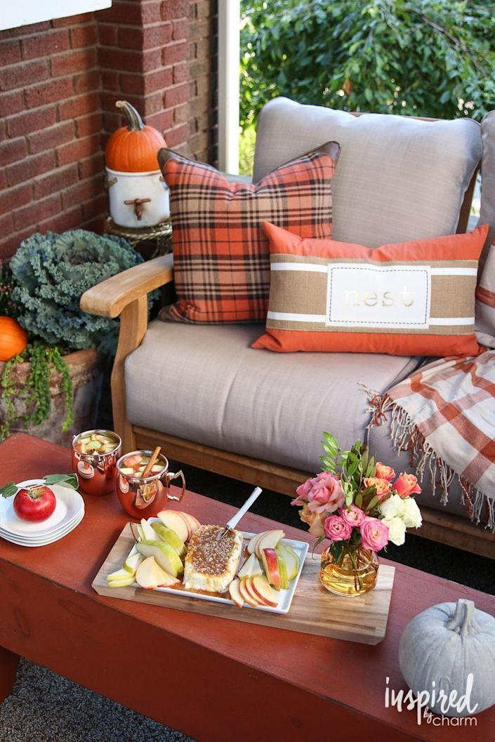 """<p>How elegant is this set-up? Make the most of the early days of fall by splurging on a few cozy, all-weather blankets and pillows. </p><p><strong>Get the tutorial at <a href=""""https://inspiredbycharm.com/fall-entertaining-around-my-house-tour/"""" rel=""""nofollow noopener"""" target=""""_blank"""" data-ylk=""""slk:Inspired by Charm"""" class=""""link rapid-noclick-resp"""">Inspired by Charm</a>.</strong></p><p><strong><a class=""""link rapid-noclick-resp"""" href=""""https://go.redirectingat.com?id=74968X1596630&url=https%3A%2F%2Fwww.walmart.com%2Fsearch%2F%3Fquery%3Doutdoor%2Bpillows&sref=https%3A%2F%2Fwww.thepioneerwoman.com%2Fhome-lifestyle%2Fdecorating-ideas%2Fg36732301%2Foutdoor-fall-decorations%2F"""" rel=""""nofollow noopener"""" target=""""_blank"""" data-ylk=""""slk:SHOP PILLOWS"""">SHOP PILLOWS</a></strong></p>"""