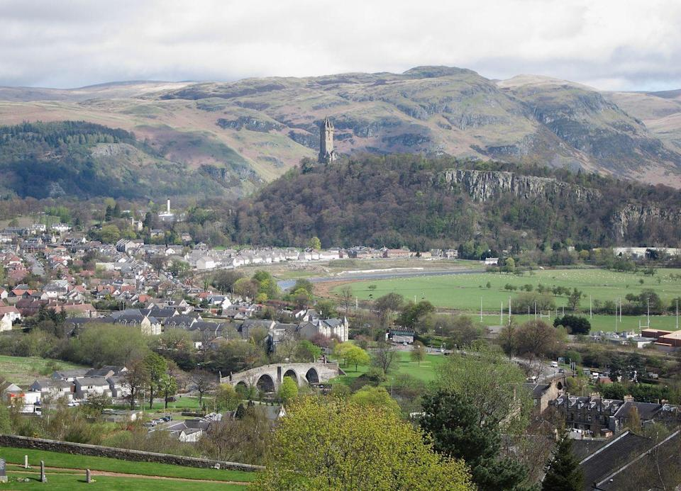 """<p>The National Wallace Monument, on the summit of Abbey Craig, looks over the town of Sterling. It commemorates Sir William Wallace, a 13th-century Scottish hero.</p><p><strong>We want to help you stay inspired. <a href=""""https://hearst.emsecure.net/optiext/optiextension.dll?ID=7YU7qVoYVtfwDQ9FRmu13FlJO1voc2zWFpXEkCOg3fHM93yYTOZhzXhAkCYFJ0k4z8Lej9Pfnfdp7K"""" rel=""""nofollow noopener"""" target=""""_blank"""" data-ylk=""""slk:Sign up"""" class=""""link rapid-noclick-resp"""">Sign up</a> for the latest travel tales and to hear about our financially protected escapes and bucket list adventures.</strong></p><p><a class=""""link rapid-noclick-resp"""" href=""""https://hearst.emsecure.net/optiext/optiextension.dll?ID=7YU7qVoYVtfwDQ9FRmu13FlJO1voc2zWFpXEkCOg3fHM93yYTOZhzXhAkCYFJ0k4z8Lej9Pfnfdp7K"""" rel=""""nofollow noopener"""" target=""""_blank"""" data-ylk=""""slk:SIGN UP"""">SIGN UP</a></p>"""