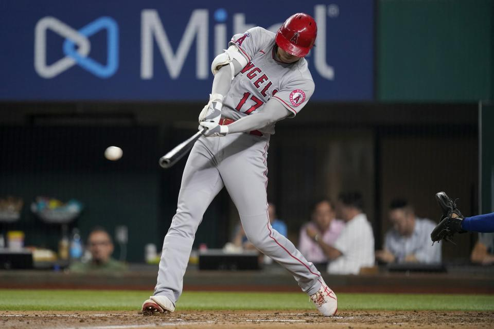 Los Angeles Angels' Shohei Ohtani connects for a double in the fifth inning of the team's baseball game against the Texas Rangers in Arlington, Texas, Tuesday, Aug. 3, 2021. (AP Photo/Tony Gutierrez)