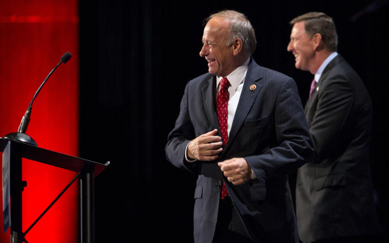 FILE - In this Aug. 10, 2013 file photo, Rep. Steve King, R-Iowa, center, gets ready to speak at the family leadership summit in Ames, Iowa. Potential presidential candidates' recent burst of Iowa visits belies this reality: No one has started to do the serious spadework of preparing for a 2016 White House run in this important state. Lesser-known Republicans, on the other hand, are looking to position themselves from the outset. (AP Photo/Justin Hayworth, File)