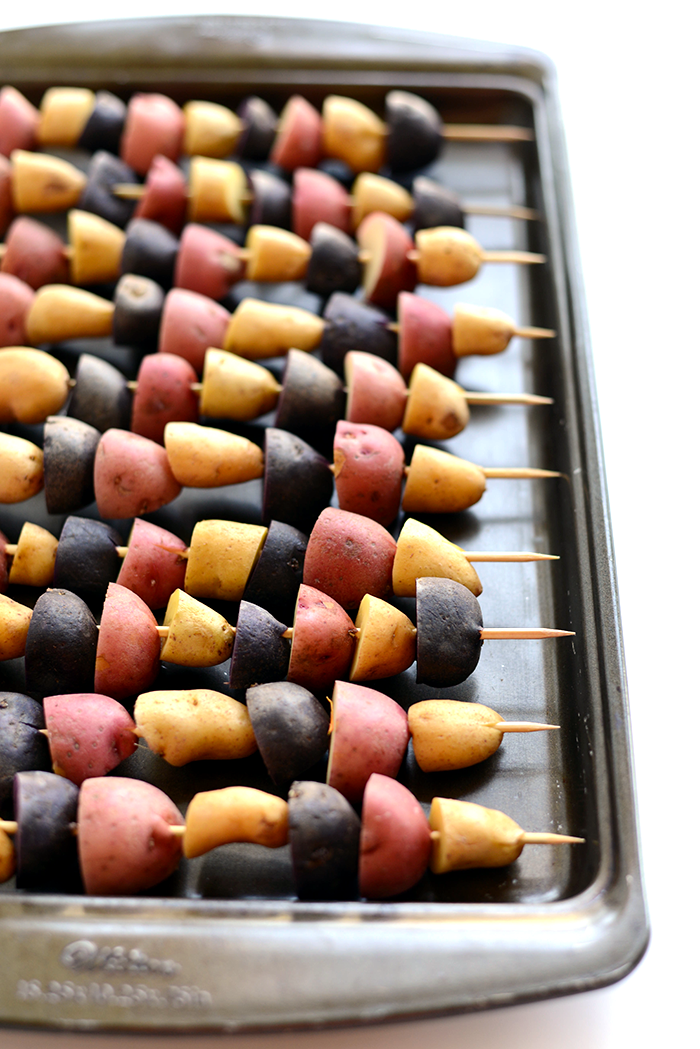 """<p>Even potatoes can be patriotic! </p><p><strong>Get the recipe at <a href=""""http://fitfoodiefinds.com/2015/06/red-white-and-blue-potato-skewers/"""" rel=""""nofollow noopener"""" target=""""_blank"""" data-ylk=""""slk:Fit Foodie Finds"""" class=""""link rapid-noclick-resp"""">Fit Foodie Finds</a>.</strong></p><p><strong><strong><a class=""""link rapid-noclick-resp"""" href=""""https://go.redirectingat.com?id=74968X1596630&url=https%3A%2F%2Fwww.walmart.com%2Fip%2FThe-Pioneer-Woman-Wildflower-Whimsy-21-Inch-Turkey-Platter%2F488343750&sref=https%3A%2F%2Fwww.thepioneerwoman.com%2Ffood-cooking%2Fmeals-menus%2Fg32157273%2Ffourth-of-july-appetizers%2F"""" rel=""""nofollow noopener"""" target=""""_blank"""" data-ylk=""""slk:SHOP PLATTERS"""">SHOP PLATTERS</a></strong><br></strong></p>"""