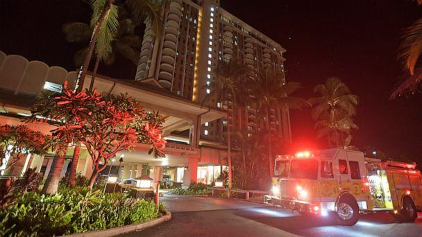 In this Tuesday, Aug. 6, 2019, photo, first responders from Honolulu Fire Department and Honolulu Police Department arrive at the Grand Waikikian in response to a fire reported on the 28th floor, in Honolulu. (Bruce Asato/Honolulu Star-Advertiser via AP) (The Associated Press)