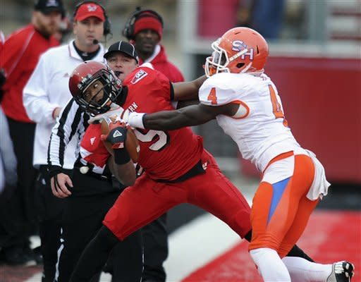 Eastern Washington receiver Shaquille Hill (9) is forced out of bounds by Sam Houston State's Bookie Sneed (4) during the first half of an FCS semifinal playoff NCAA college football game on Saturday, Dec. 15, 2012, in Cheney, Wash. (AP Photo/The Spokesman-Review, Tyler Tjomsland)