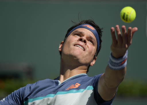 Milos Raonic, of Canada, serves to Miomir Kecmanovic, of Serbia, at the BNP Paribas Open tennis tournament Thursday, March 14, 2019, in Indian Wells, Calif. (AP Photo/Mark J. Terrill)
