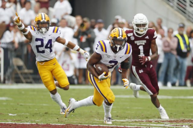 LSU safety JaCoby Stevens (3) runs the other way with an interception intended for Mississippi State wide receiver Stephen Guidry (1) during the first half of their NCAA college football game in Starkville, Miss., Saturday, Oct. 19, 2019. (AP Photo/Rogelio V. Solis)