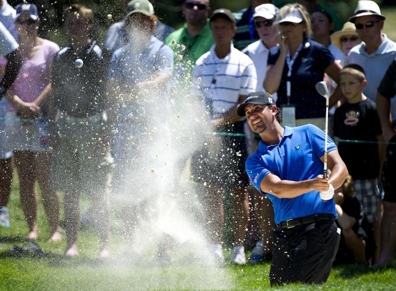 Scott Piercy chips out of the bunker on the first hole during the final round of the Canadian Open golf tournament at Hamilton Golf and County Club, Sunday, July 29, 2012, Ancaster, Ontario. (AP Photo/The Canadian Press,Nathan Denette)